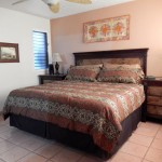 Large master bedroom with kingsize bed with space on both side of the bed for a wheelchair 150x150 - Maui Accessible Condo