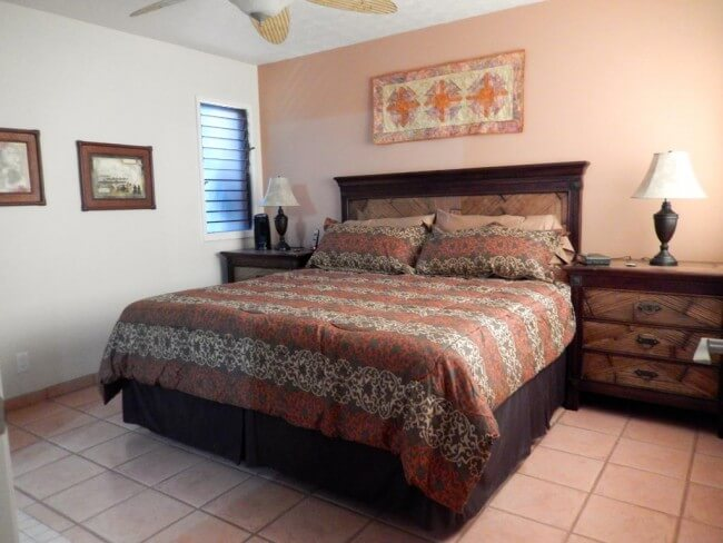 Large master bedroom with kingsize bed with space on both side of the bed for a wheelchair - Maui Accessible Condo