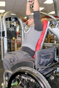 sitandbeFitPhoto1 200x300 - Man in a wheelchair working out at a gym