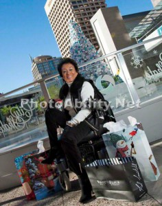 JeanChristmas 236x300 - Mature woman in a power wheelchair doing her Christmas shopping in the city