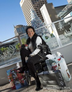 moriki 236x300 - Mature woman in a power wheelchair doing her Christmas shopping in the city