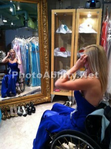 Monica inthe Mirror 224x300 - Young woman using a wheelchair trying on a new dress