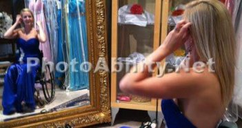 Woman in wheelchair in blue dress looking in the mirror