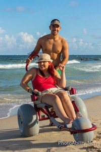 jessikashootblog 200x300 - Young woman enjoying the ocean in a beach wheelchair