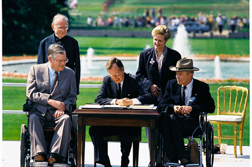 Bush signs in ADA of 1990 - Don't Take Discrimination Sitting Down! Educate yourself on the Law