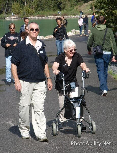 Man walking with wife using walker 461x600 - Is Accessible Travel Marketing Really Good Business?