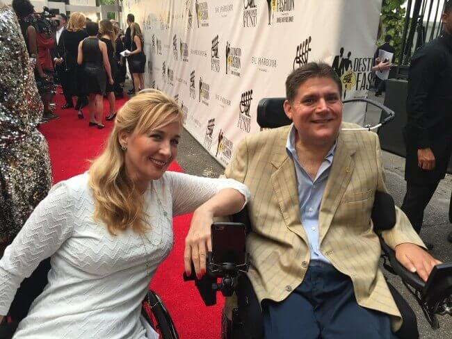 Marc Buoniconti, Executive Director of Miami Project to Cure Paralysis on Red Carpet with Deborah Davis of PUSHLiving posing for cameras seating in wheelchairs (marc -Electric, Deborah-manual)