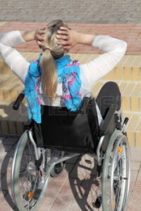27711318 a young female wheelchair user in front of a stair 200x300 - woman in wheelchair unable to access stairs
