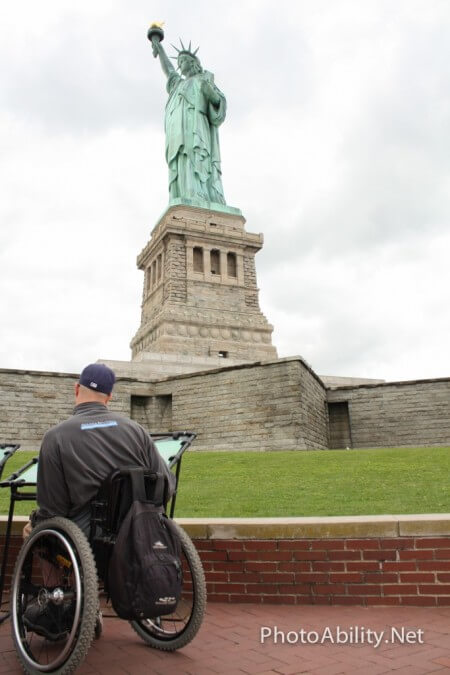 Man in wheelchair at Statue of Liberty