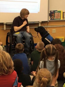 Casey with Service dog demonstrating to school children 225x300 - Casey with Service dog demonstrating to school children