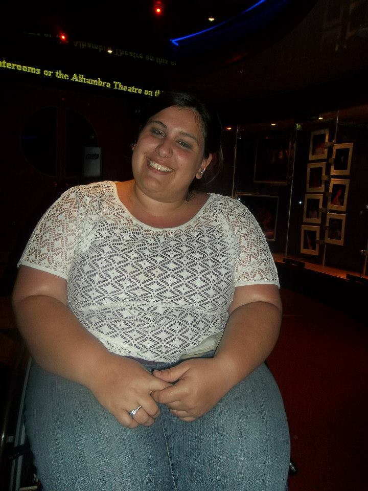 picture of a fat healthy woman sitting and smiling
