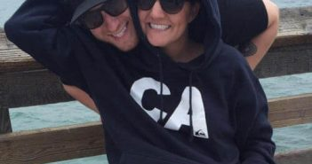 Gina and Nick on Pier wearing hats and sunglasses in overcast cool weather