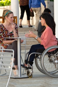 Ilena by Todd Kelso for Pushlivingphotos 200x300 - Woman in a wheelchair in a cafe with her friend