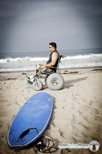 Paraplegic man in beach wheelchair looking at the ocean 200x300 - Beach Wheelchairs: Making Summer Fun Accessible for ALL