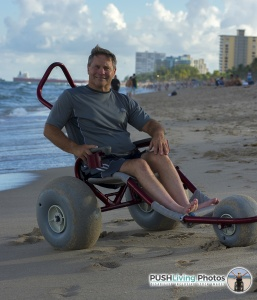 Paraplegic man in wheelchair at beach 257x300 - Beach Wheelchairs: Making Summer Fun Accessible for ALL