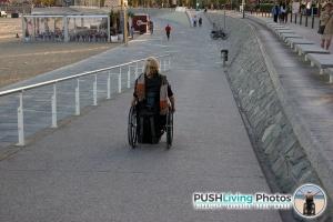 Paraplegic woman in wheelchair on walkway 300x200 - Paraplegic woman in wheelchair on walkway