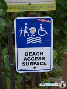 beach wheelchair access surface sign 225x300 - Beach Wheelchairs: Making Summer Fun Accessible for ALL