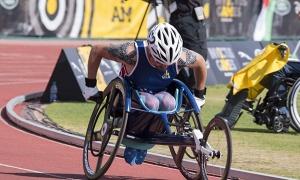 man racing in wheelchair track 300x180 - Invictus Field Sports