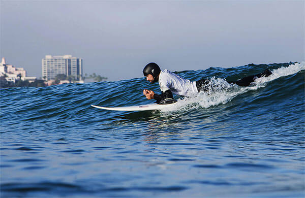 World champion quadriplegic surfer Jesse Billauer surfing on a surfing board in sea