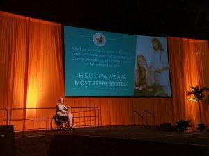 Deborah in a wheelchair giving a speech 300x225 - Deborah Davis in a wheelchair giving a speech