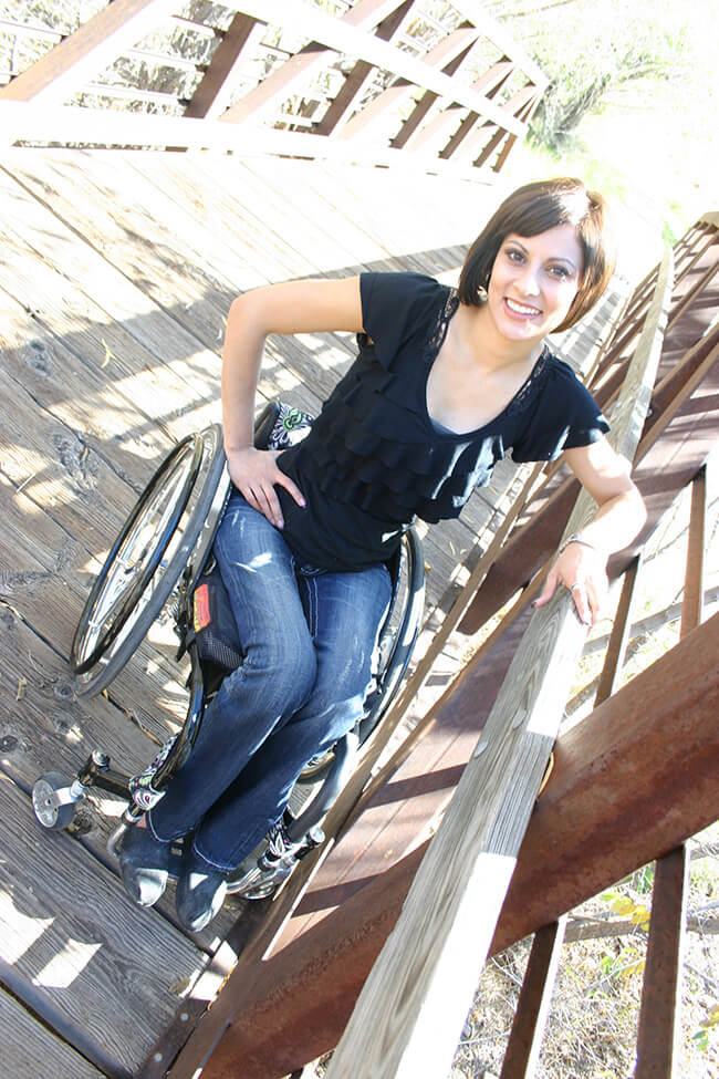Lori on wheelchair - Mom of Four Created a Chemical Free Home and Business She Could Believe In
