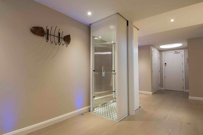 image of a home elevator in a beautiful corridor of a home