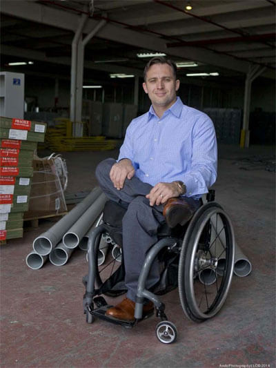 image of a man sitting on a wheelchair smiling
