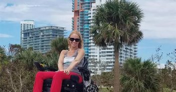 young disabled gorgeous blonde woman in a power wheelchair enjoying a beach vacation
