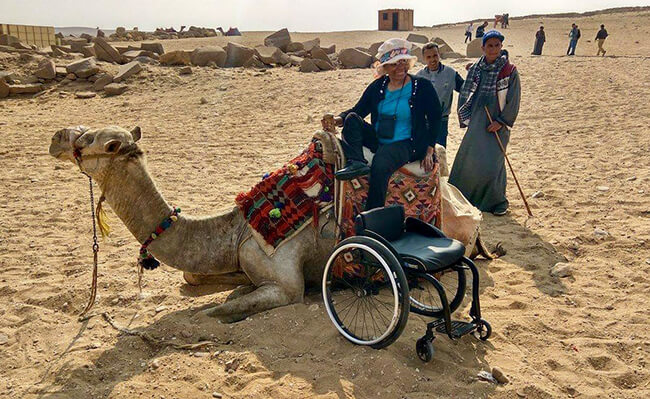 Alana Wallace in Dubai on Safari on camel - Sassy, Single and 66! Changing Perceptions of What a Woman Her Age with a Disability, Can and Will Do!