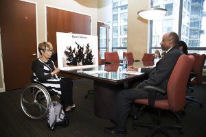 PL 8JZPUJS original 300x200 - Woman using a wheelchair presenting in a board meeting