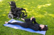 Young disable women exercising in the park