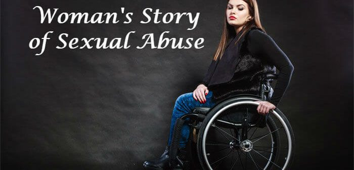 Young woman sitting in a wheelchair looking sad