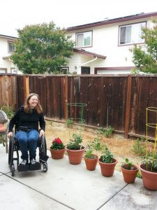 Metoo Story of My Vulnerability as a Disabled Woman 2 225x300 - Disabled Woman Sitting on a Wheelchair Laughing in a Garden