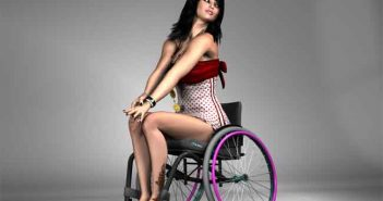 Kim is sitting on a Wheelchair and posing confidently