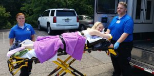 20160608 143806 1 300x149 - Quirky Quad in the stretcher with the two EMTs
