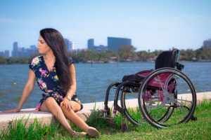 PL LGECXTU original 300x200 - Young woman in a wheelchair in a coastal park
