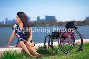 pushliving 3 300x200 - Young woman in a wheelchair in a coastal park