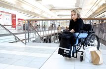 A woman with wheelchair in a shopping mall