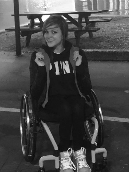 Happy Girl in a wheelchair 450x600 - Surviving Abuse Should Be Celebrated