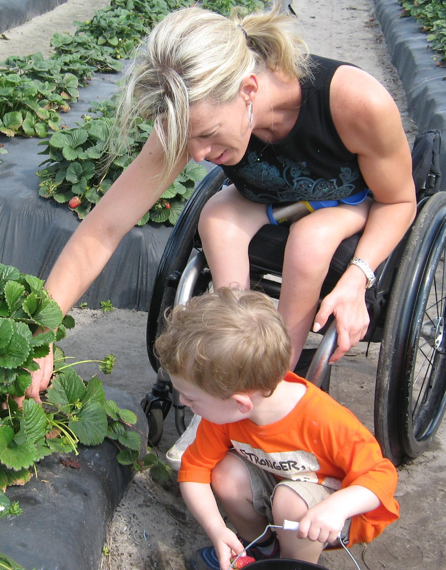 Cheryl Picking Vegetables at a wheelchair accessible garden with her son - Wheelchair Accessible Farming and Gardening