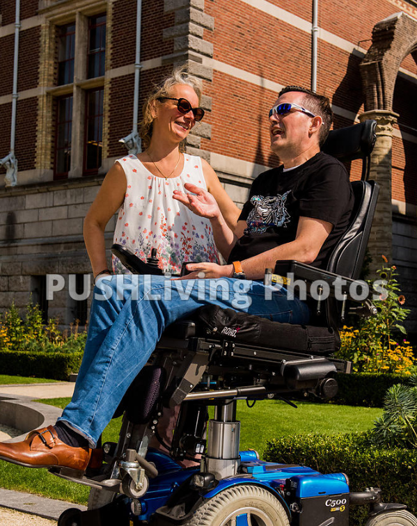 Couple using power wheelchairs talking in a museum garden - 9 Healthy Living Tips for Wheelchair Users