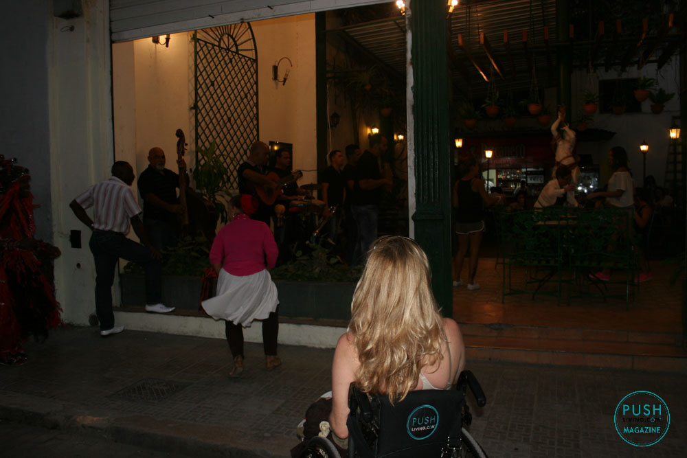 woman in wheelchair watching people dancing