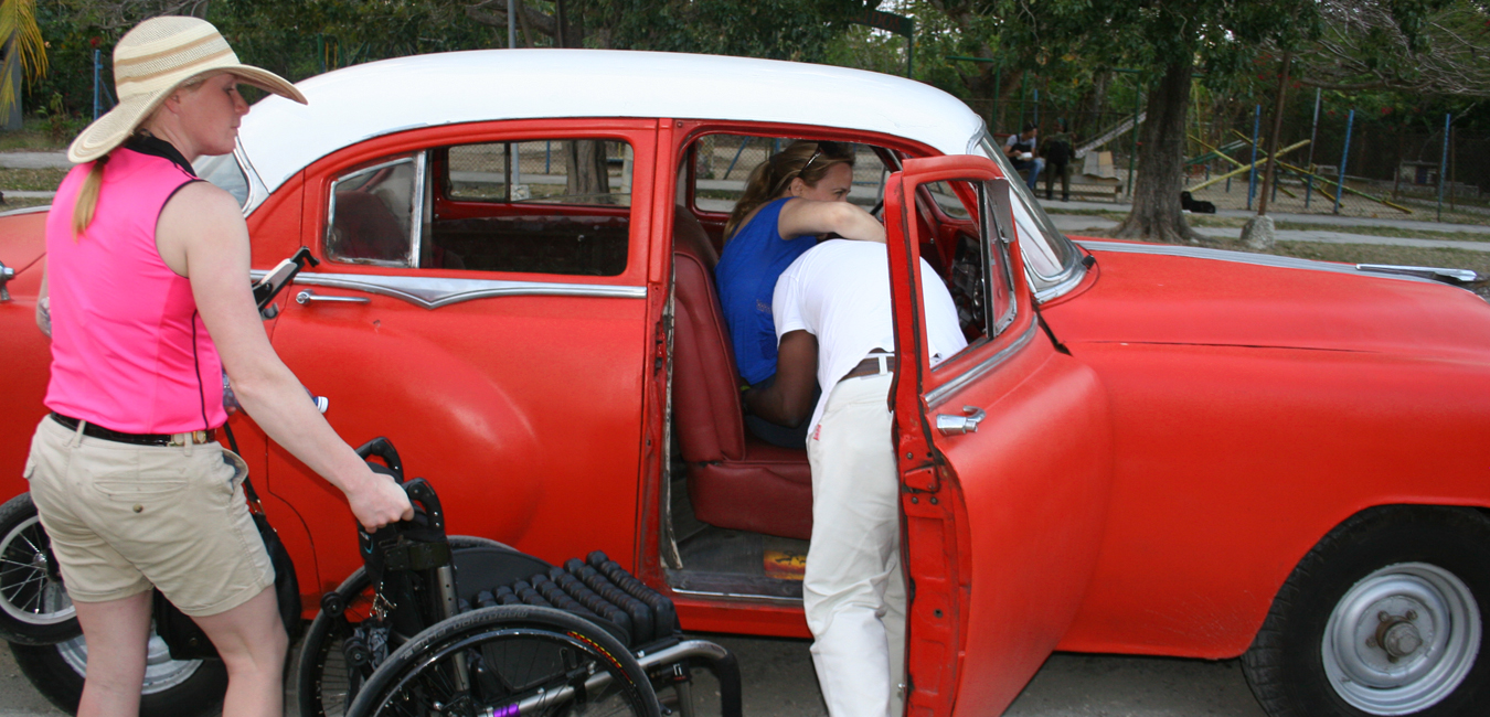 Deborah Davis Being Lifted into a Car - Wheelchair Travel: Cuba Libre? How Free is Cuba for Travelers on Wheels?