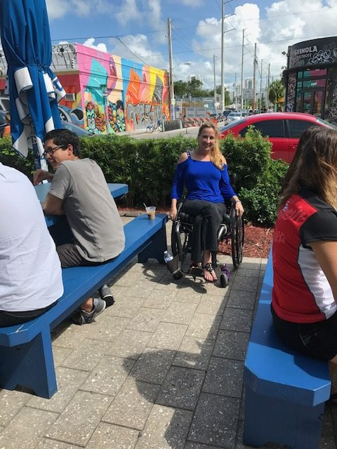 Woman in wheelchair at Wynwood Miami e1561001481259 - Where to Roll in Town:  A Wheelchair Users Guide to What is Hot and Trending in Travel