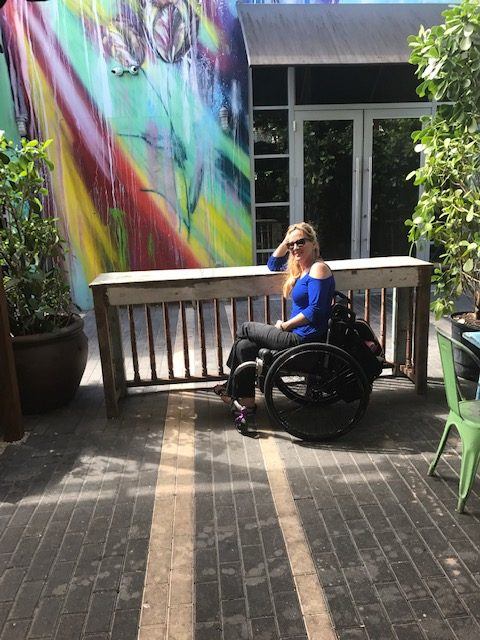 Woman in wheelchair at Wynwood Wall Art e1561001459899 - Where to Roll in Town: A Wheelchair Users Guide to What is Hot and Trending in Travel