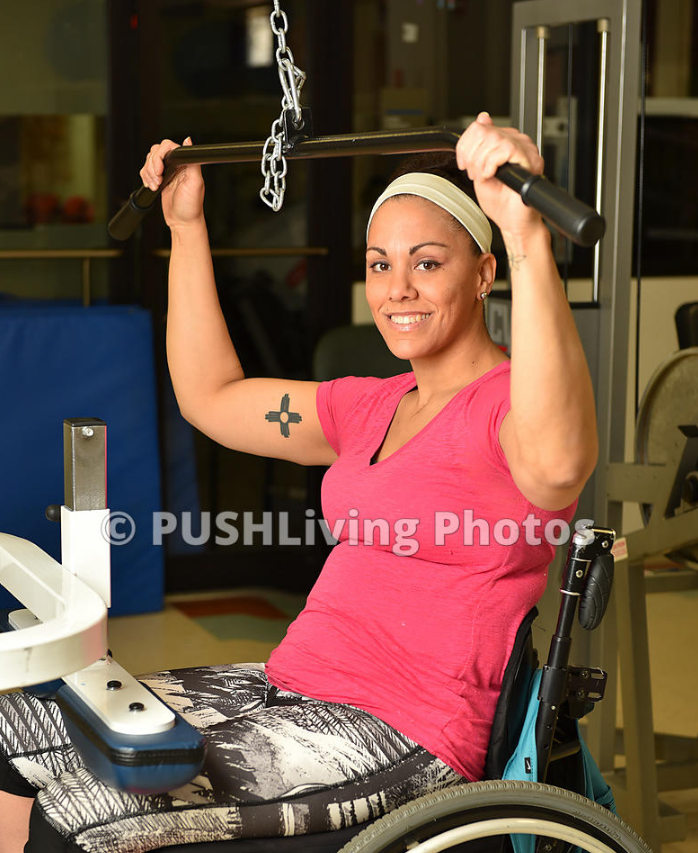 Young woman using a wheelchair exercising in a gym - 9 Healthy Living Tips for Wheelchair Users