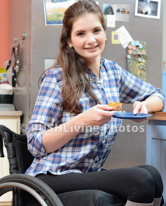 Young woman using a wheelchair relaxing with a slice of cake 242x300 - Young woman using a wheelchair relaxing with a slice of cake
