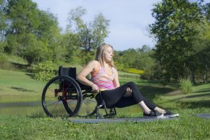 PL 07YJCZ0 original 300x200 - Young woman using a wheelchair exercising in a park. (Photo ©2015 George C. Anderson from PUSHLivingPhotos.com)
