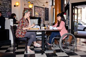 PL 0RSQ8EE original 300x200 - Woman in a wheelchair in a cafe with her friend. (Photo from PUSHLivingPhotos.com)