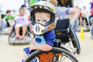 PL 1LIQ4CI original 300x200 - Young boy in a wheelchair at a sports clinic